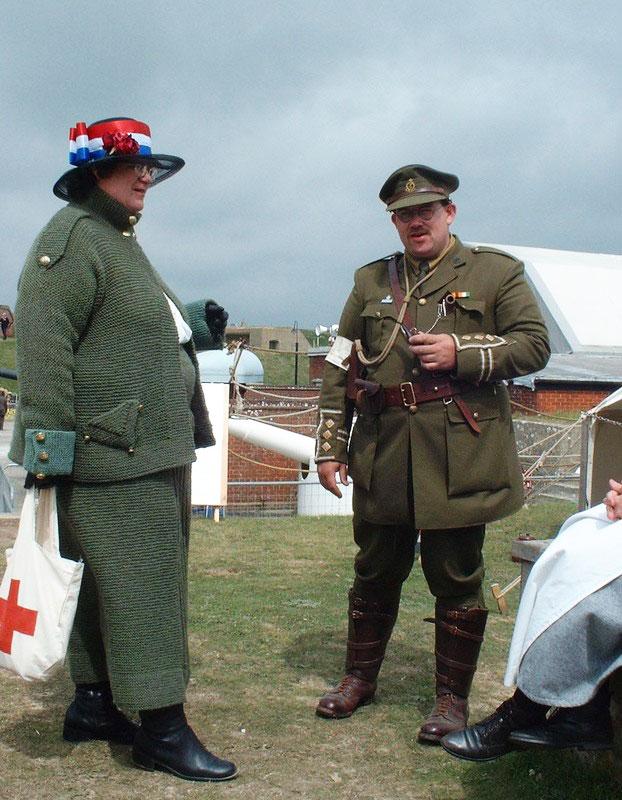 Joyce demonstrating knitted World War I garments in a re-enactment at Fort Nelson